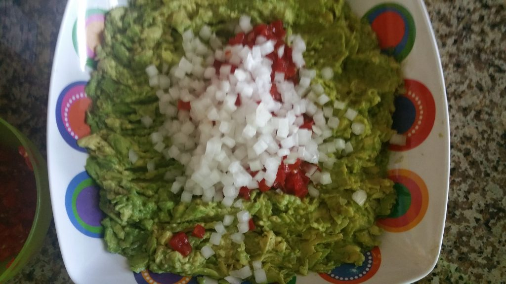 add onions to tomatoes and avocados