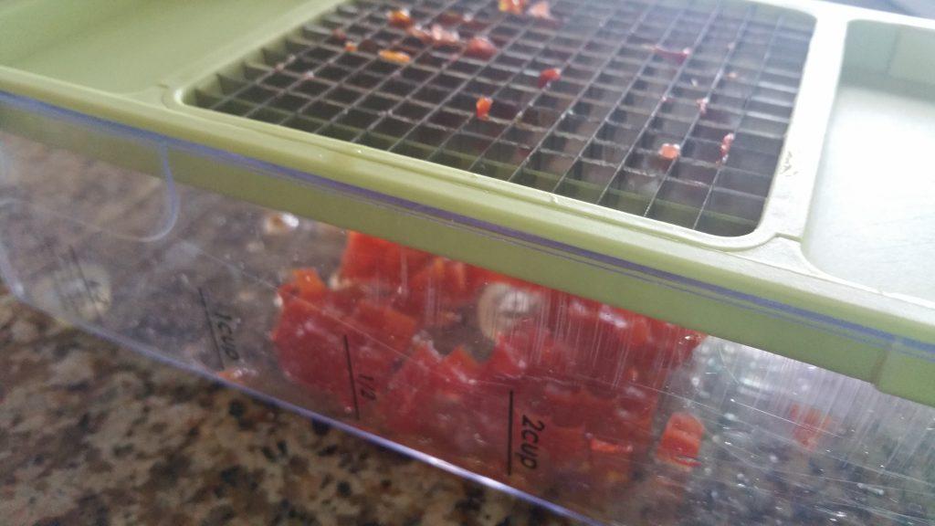 Catches little cubes inside chopper